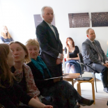 A moment from defense. The review of the President of Lithuanian Graphic Association Gediminas Lašas (standing).